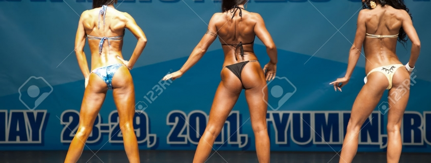 Tyumen, Russia - May 28, 2011: European Women Bodybuilding, Fitness, Bodyfitness, Bikini and Men Fitness Championships. Prejudging - Morning session. Back view